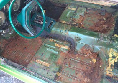 rust under car carpeting